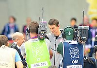 """August 04, 2012..Michael Phelps is being presented with """"The Greatest Olympic Athlete of All Times"""" trophy at the Aquatics Center on day eight of 2012 Olympic Games in London, United Kingdom."""