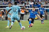 SAN JOSE, CA - AUGUST 17: Bakaye Dibassy #12 of Minnesota United is tackled by Nathan Cardoso #13 of the San Jose Earthquakes during a game between San Jose Earthquakes and Minnesota United FC at PayPal Park on August 17, 2021 in San Jose, California.