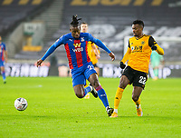 8th January 2021; Molineux Stadium, Wolverhampton, West Midlands, England; English FA Cup Football, Wolverhampton Wanderers versus Crystal Palace; Michy Batshuayi of Crystal Palace on the ball holding off Nelson Semedo of Wolverhampton Wanderers