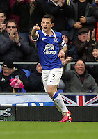 Pictured: Leighton Baines of Everton is celebrating his opening goal from the penalty spot. Saturday 22 March 2014<br /> Re: Barclay's Premier League, Everton v Swansea City FC at Goodison Park, Liverpool, UK.