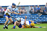 Mark Rodgers of Clare  in action against Gavin Fives and Rory Furlong of Waterford during their Munster  championship round robin game at Cusack Park Photograph by John Kelly.
