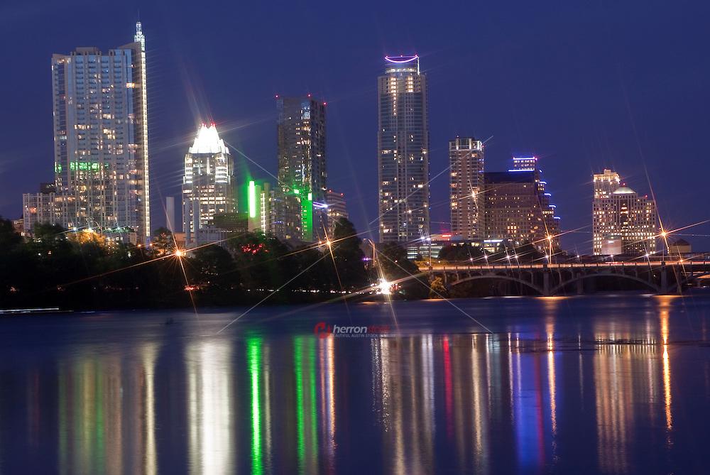 Austin Skyline with colorful nightime reflection on Lady Bird Lake.
