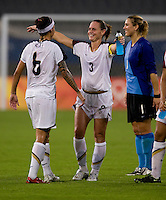 Christie Rampone, Natasha Kai. The USWNT defeated Canada in extra time, 2-1, during the 2008 Beijing Olympics in Shanghai, China.