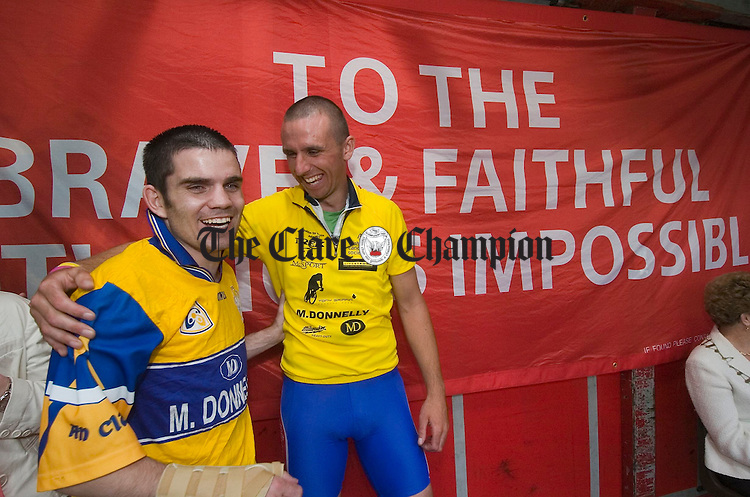 Boxer Bernard Dunne and Tony Griffin share a moment on stage. Photograph by John Kelly.