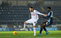 Liam Noble of Notts County holds off Aaron Pierre of Wycombe Wanderers during the Sky Bet League 2 match between Wycombe Wanderers and Notts County at Adams Park, High Wycombe, England on 15 December 2015. Photo by Andy Rowland.