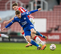 9th January 2021; Bet365 Stadium, Stoke, Staffordshire, England; English FA Cup Football, Carabao Cup, Stoke City versus Leicester City; Harvey Barnes of Leicester City is tackled by Harry Souttar of Stoke City