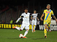 Thursday 27 February 2014<br /> Pictured L-R: Jonathan de Guzman takes a shot at goal, against him Valon Behrami of Napoli<br /> Re: UEFA Europa League, SSC Napoli v Swansea City FC at Stadio San Paolo, Naples, Italy.
