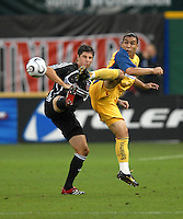 Club America forward Salvador Cabana (9) tries to gain possession of the ball while covered from behind by DC United defender Devon McTavish (18). DC United defeated Club America 1-0 to secure one of the two semifinal berths in SuperLiga group B, at RFK Stadium in Washington DC, Sunday July 29, 2007.