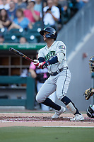 Cristian Pache (15) of the Gwinnett Stripers follows through on his swing against the Charlotte Knights at Truist Field on July 17, 2021 in Charlotte, North Carolina. (Brian Westerholt/Four Seam Images)