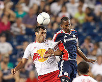 New York Red Bulls defender Wilman Conde (2) and New England Revolution substitute forward Jerry Bengtson (27) battle for head ball.  In a Major League Soccer (MLS) match, New England Revolution defeated New York Red Bulls, 2-0, at Gillette Stadium on July 8, 2012.