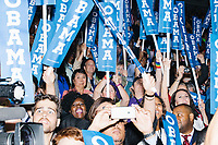 People watch as President Barack Obama speaks at the Democratic National Convention at the Wells Fargo Center in Philadelphia, Pennsylvania, on Wed., July 27, 2016.