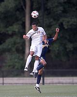 Boston College forward Charlie Rugg (17) and Quinnipiac University defender Brandon Strain-Goode (2) battle for head ball. Boston College defeated Quinnipiac, 5-0, at Newton Soccer Field, September 1, 2011.