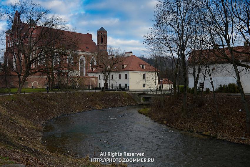Vilnia river near Uzupis, St. Anne's Church on background, Vilnius, Lithuania