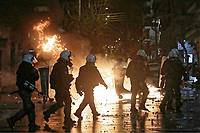 Pictured: Clashes between PAOK supporters and riot police outside the Toumba Stadium in Thessaloniki, Greece. Sunday 25 February 2018<br /> Re: Sunday's Greek Super League derby between PAOK Thessaloniki and Olympiakos was called off after Olympiakos' manager Oscar Garcia was struck in the face by an object believed to be a till machine paper roll, thrown by a spectator minutes before kick-off.<br /> Garcia left Toumba Stadium for a local hospital to seek treatment for a bloodied lip.<br /> The incident prompted the Olympiakos team to leave the pitch in protest before riots erupted outside the ground.<br /> Angry PAOK fans leaving the stadium then clashed with police who used tear gas to quell the violence.