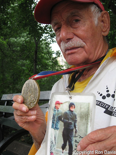 "Alberto Arroyo was known as ""the Mayor of Central Park for 70 years"". He was awarded the prestigious Medal For Overcoming Adversity. This photo was taken in Central Park, NYC, June '06.  Mr. Arroyo passed away in 2010 at the age of 94 years. A former boxer from Puerto Rico, Arroyo had taken to running in Central Park along the bridle path, but after a police officer told him he was bothering the horses, Arroyo ran around the reservoir. That was 1937. Arroyo also used to run during his lunch hour while working at Bethlehem Steel in Battery Park, which was unheard of back then, and ran in the first NYC marathon. In more recent years, Arroyo would walk clockwise around the reservoir with a walker, greeting runners and offering them encouragement. He was even given a State Senate resolution in 1985, acknowledging his 50 years of running and calling him one of the ""pioneers of the jogging trend."""