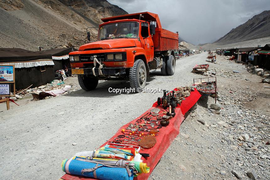 "China started building a controversial 67-mile ""paved highway fenced with undulating guardrails"" to Mount Qomolangma, known in the west as Mount Everest, to help facilitate next year's Olympic Games torch relay./// A truck rolls through the tent village guesthouses at Everest Base Camp.<br /> Tibet, China<br /> July, 2007"