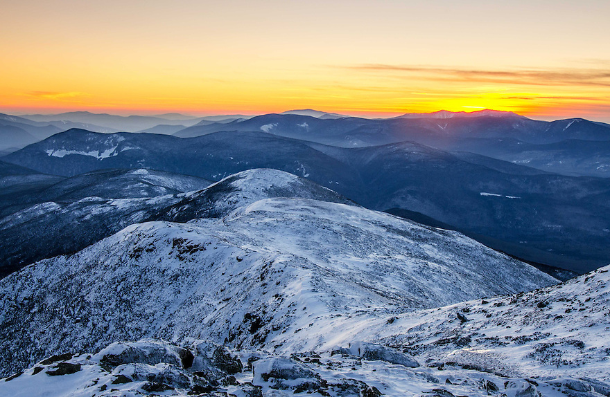 The last minutes of light color the sky over the southern Presidential Range in this winter White Mountain landscape.