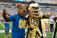The Pitt Panthers mascot and the UCF Knights mascot pose for a photo. The Pitt Panthers defeated the UCF Knights 35-34 in a football game played at Heinz Field, Pittsburgh, Pennsylvania on September 21, 2019.