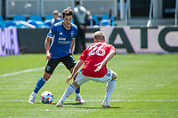 SAN JOSE, CA - APRIL 24: Carlos Fierro #7 of the San Jose Earthquakes dribbles past John Nelson #26 of FC Dallas during a game between FC Dallas and San Jose Earthquakes at PayPal Park on April 24, 2021 in San Jose, California.