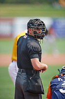 Umpire Anthony Perez handles the calls at the plate during the game between the Salt Lake Bees and the Las Vegas Aviators at Smith's Ballpark on July 25, 2021 in Salt Lake City, Utah. The Aviators defeated the Bees 10-6. (Stephen Smith/Four Seam Images)