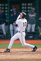 Pavin Smith (10) of the Virginia Cavaliers follows through on his swing against the Hartford Hawks at The Ripken Experience on February 27, 2015 in Myrtle Beach, South Carolina.  The Cavaliers defeated the Hawks 5-1.  (Brian Westerholt/Four Seam Images)