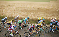 green jersey André Greipel (DEU/Lotto-Soudal) in the peloton over the sector Pont-à-Celles (1800m) cobbles<br /> <br /> stage 4: Seraing (BEL) - Cambrai (FR) <br /> 2015 Tour de France