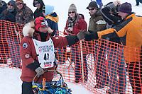 Lou Packer team leaves the start line during the restart day of Iditarod 2009 in Willow, Alaska