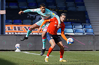 (L-R) Kyle Naughton of Swansea City challenges Harry Cornick of Luton Town during the Sky Bet Championship match between Luton Town and Swansea City at Kenilworth Road, Luton, England, UK. Saturday 13 March 2021