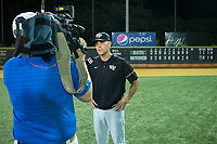 Wake Forest Demon Deacons head coach Tom Walter (16) is interviewed by WFMY-TV cameraman Brian James Hall following the win over the West Virginia Mountaineers in Game Six of the Winston-Salem Regional in the 2017 College World Series at David F. Couch Ballpark on June 4, 2017 in Winston-Salem, North Carolina.  The Demon Deacons defeated the Mountaineers 12-8.  (Brian Westerholt/Four Seam Images)