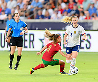 HOUSTON, TX - JUNE 10: Andreia Norton #8 of Portugal attempts to trip Samantha Mewis #3 of the United States to keep her from moving the ball up the field during a game between Portugal and USWNT at BBVA Stadium on June 10, 2021 in Houston, Texas.