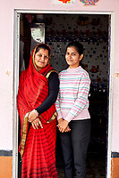 Pintu Panday and one of her daughters in the doorway of their home in Rajasthan