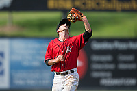 Kannapolis Intimidators shortstop Grant Massey (28) catches a fly ball in shallow left field during the game against the Greensboro Grasshoppers at Kannapolis Intimidators Stadium on August 13, 2017 in Kannapolis, North Carolina.  The Grasshoppers defeated the Intimidators 4-1 in 10 innings in the completion of a game suspended on August 12, 2017.  (Brian Westerholt/Four Seam Images)