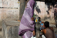 A woman in colourful clothing walks along the street in Kolkata.<br /> <br /> To license this image, please contact the National Geographic Creative Collection:<br /> <br /> Image ID: 1925728 <br />  <br /> Email: natgeocreative@ngs.org<br /> <br /> Telephone: 202 857 7537 / Toll Free 800 434 2244<br /> <br /> National Geographic Creative<br /> 1145 17th St NW, Washington DC 20036
