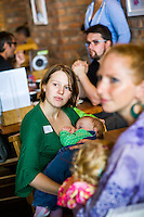 Mothers who have come together to celebrate the annual Big Latch On breastfeeding promotion event breastfeeding in a cafe. Dorset, England, UK<br /> <br /> 02/08/2014<br /> <br /> <br /> © Paul Carter / wdiip.co.uk