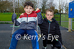 Enjoying the swings in the Listowel town park on Friday, l to r: Adam O'Connell and Aaron Hickey.