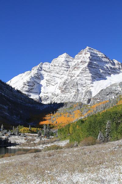 Autumn snow and the Maroon Bells Peaks, Aspen, Colorado John offers fall foliage photo tours throughout Colorado.