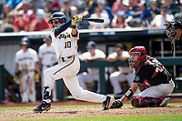Michigan Wolverines third baseman Blake Nelson (10) follows through on his swing during Game 1 of the NCAA College World Series against the Texas Tech Red Raiders on June 15, 2019 at TD Ameritrade Park in Omaha, Nebraska. Michigan defeated Texas Tech 5-3. (Andrew Woolley/Four Seam Images)