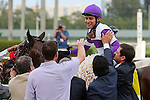 HALLANDALE BEACH, FL -APRIL 02:   #4 Nyquist (KY) with jockey Mario Qutierrez on board celebrates before heading into the winner's circle after winning the Florida Derby GI on April 2nd, 2016 at Gulfstream Park in Hallandale Beach, Florida. (Photo by Liz Lamont/Eclipse Sportswire/Getty Images)