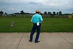 Trainer Larry Jones takes in the action between races at Ellis Park in Henderson, Ky., Sunday afternoon, Aug. 9, 2020.