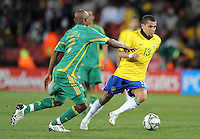 Dani Alves of Brazil and Tsepo Masilena of South Africa. Brazil defeated South Africa 1-0 during the semi-finals of the FIFA Confederations Cup at Ellis Park Stadium in Johannesburg, South Africa on June 25, 2009..