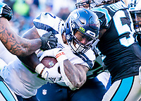 CHARLOTTE, NC - DECEMBER 15: Chris Carson #32 of the Seattle Seahawks carries the bsll during a game between Seattle Seahawks and Carolina Panthers at Bank of America Stadium on December 15, 2019 in Charlotte, North Carolina.