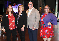 Carrie Miller, SPSFNWA chief program officer (from left); Shannon Campbell, chief operating officer; Tyler B. Clark, chief executive officer; and Frankie Rankin, chief philanthropy officer, welcome guests to the merger celebration July 7 at Record in Bentonville. <br /> (NWA Democrat-Gazette/Carin Schoppmeyer)