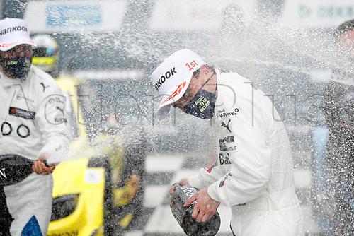 23rd August 2020, Lausitz Circuit, Klettwitz, Brandenburg, Germany. The Deutsche Tourenwagen Masters (DTM) race at Lausitz;  Lucas Auer AUT, Team RMG, BMW M4 DTM celebrates with champagne