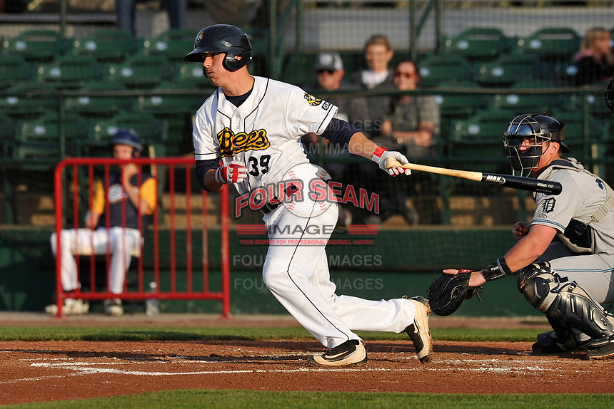 Burlington Bees catcher Jack Kruger (39) swings during a game against the West Michigan Whitecaps at Community Field on May 11, 2017 in Burlington, Iowa.  The Whitecaps won 10-3.  (Dennis Hubbard/Four Seam Images)