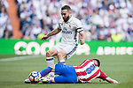 Daniel Carvajal Ramos (l) of Real Madrid fights for the ball with Saul Niguez Esclapez of Atletico de Madrid during their La Liga match between Real Madrid and Atletico de Madrid at the Santiago Bernabeu Stadium on 08 April 2017 in Madrid, Spain. Photo by Diego Gonzalez Souto / Power Sport Images