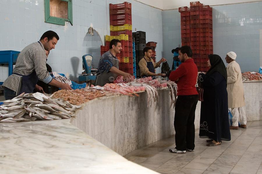 Tripoli, Libya - Fish Market, Rashid Street.  Woman Wearing Abaya.