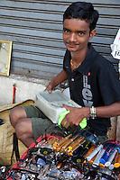 Myanmar, Burma, Yangon.  Sidewalk Eyeglass Salesman.