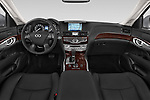 Stock photo of straight dashboard view of a 2015 Infiniti Q70 Premium 4 Door Sedan 2WD Dashboard