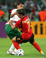 Mario Mendez (16) of Mexico and Figueredo (7) of Angola get tangled up. Mexico and Angola played to a 0-0 tie in their FIFA World Cup Group D match at FIFA World Cup Stadium, Hanover, Germany, June 16, 2006.