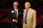 Louis Pearce and Mayor Bill White chat during the city's 170th birthday celebration on stage at the Wortham Theater Wednesday 23,2006. (Dave Rossman/For the Chronicle)